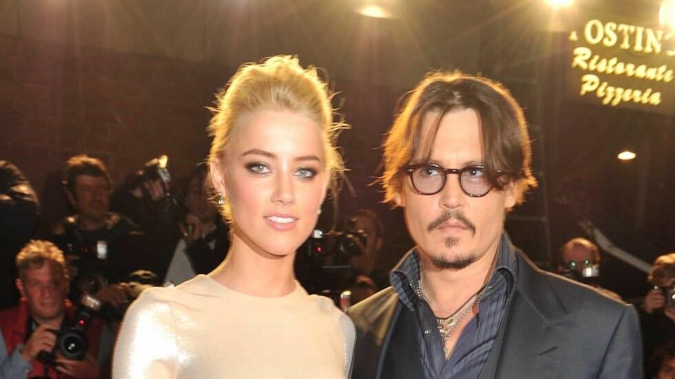 FLYTTER SAMMEN: The Sun hevder at Johnny Depp og Amber Heard skal bli samboere. Foto: Fame Flynet