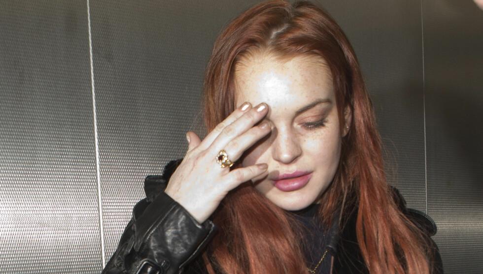 TØFF TID: De dårlige nyhetene står i kø for Lindsay Lohan. Nå har det amerikanske skattevesenet IRS ifølge nettsiden TMZ sperrert alle hennes bankkontoer fordi hun skylder over en million norske kroner. Foto: All Over Press