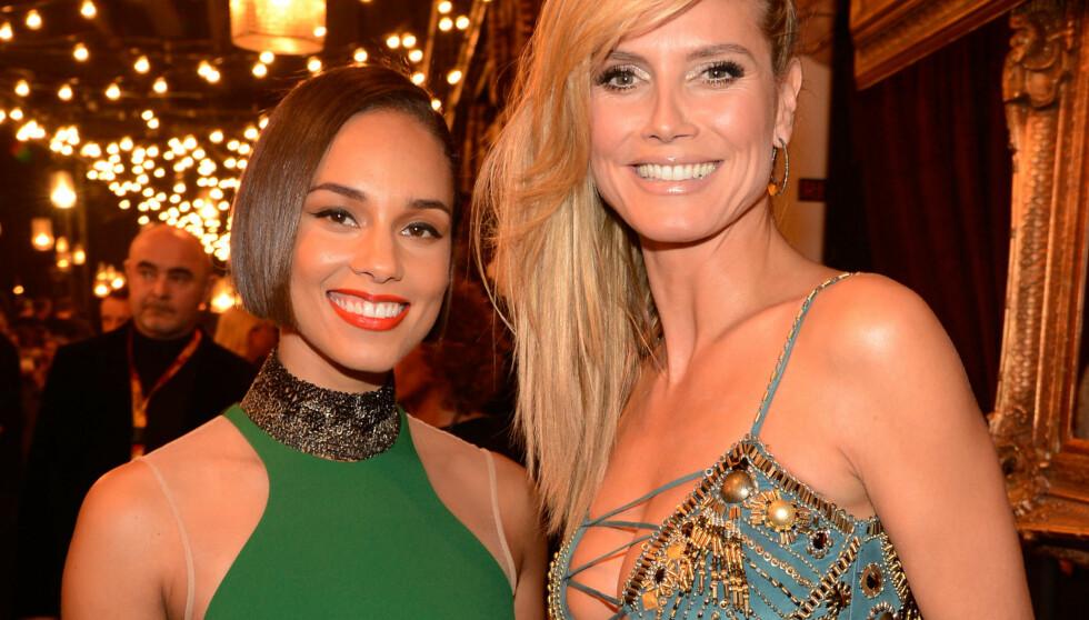 STRÅLTE SAMMEN: Album-aktuelle Alicia Keys (t.v) kastet glans over MTV Awards i Frankfurt nylig. Hun så ut til å ha det hyggelig sammen med supermodell Heidi Klum. Foto: All Over Press