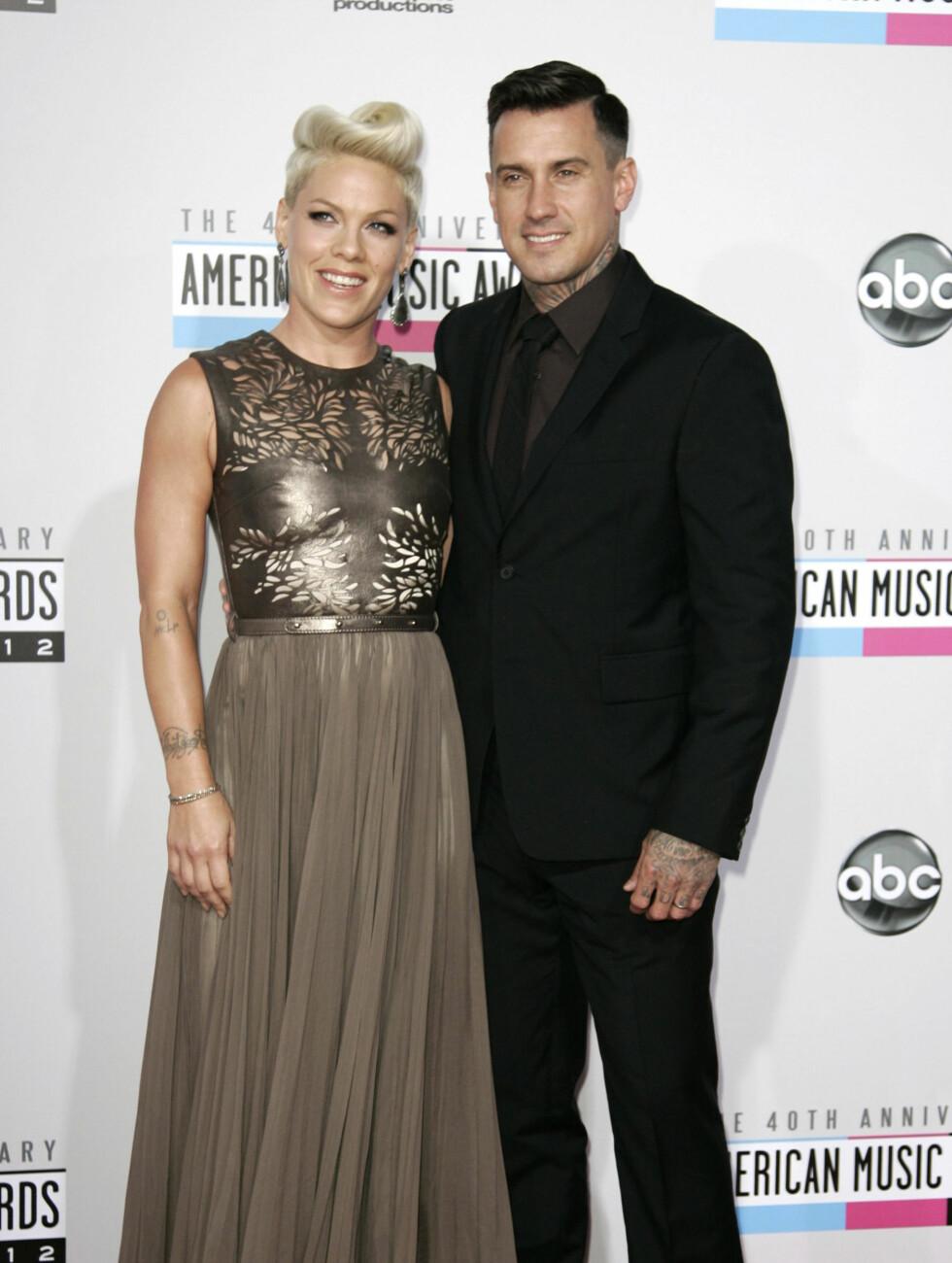 Popstjernen Pink og ektemannen Carey Hart. Foto: NTBScanpix