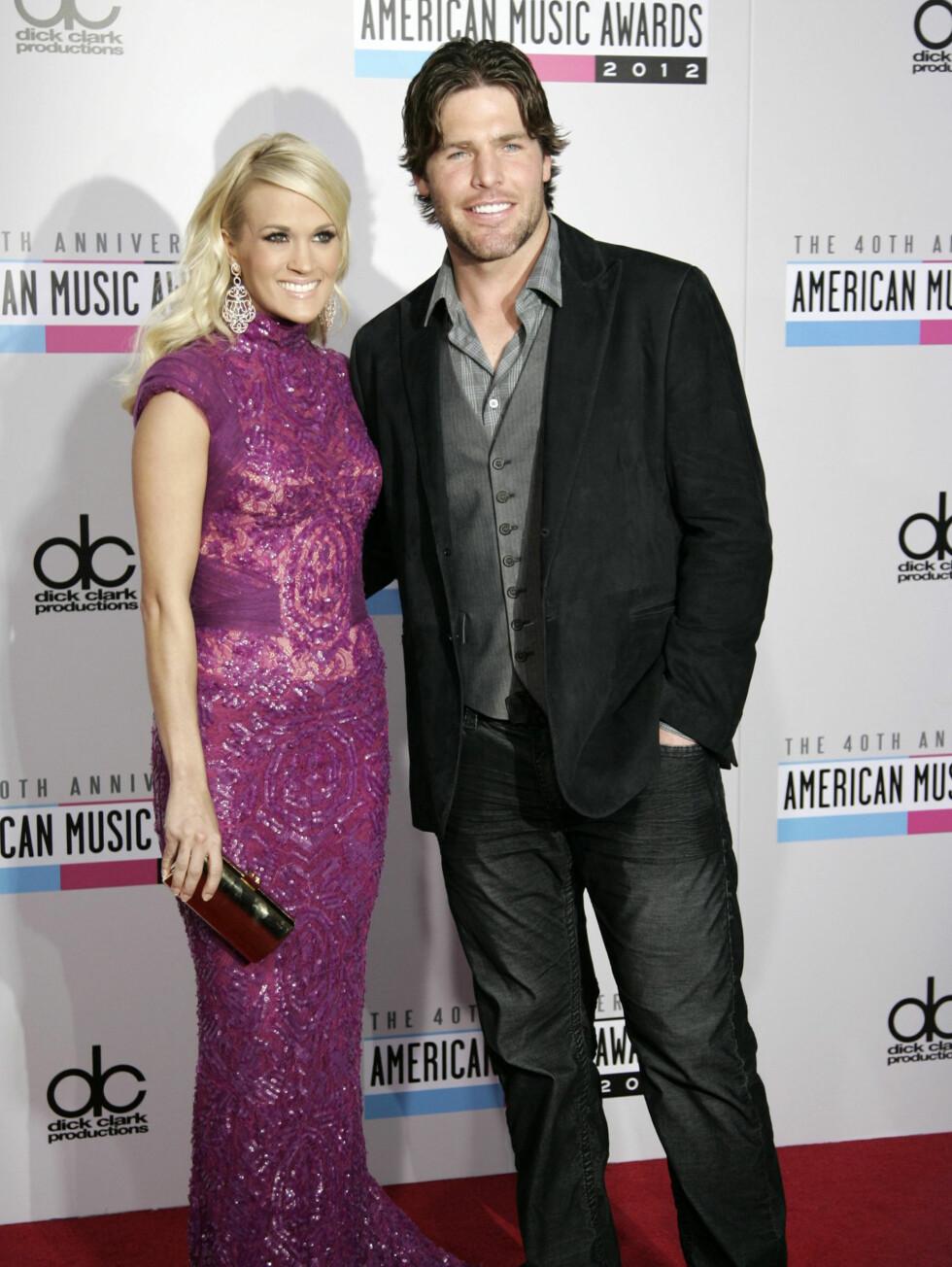 Sangfuglen Carrie Underwood og ektemannen Mike Fisher. Foto: NTBScanpix