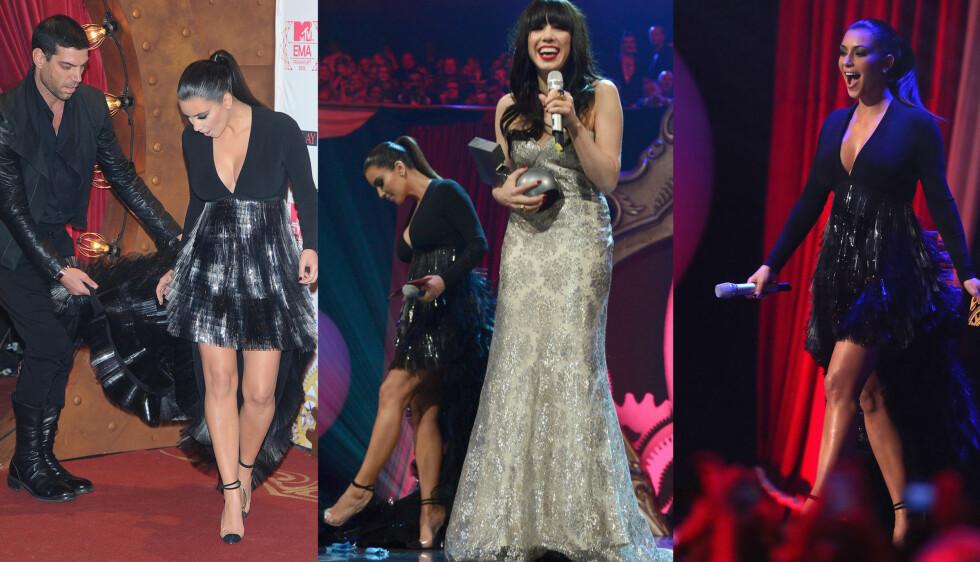 SNUBLET: De skyhøye Louis Vuitton-skoene og kjolens slep skapte problemer for Kim Kardashian som holdt på å falle av scenen under showet, og hun måtte stadig ha hjelp med kjolen.