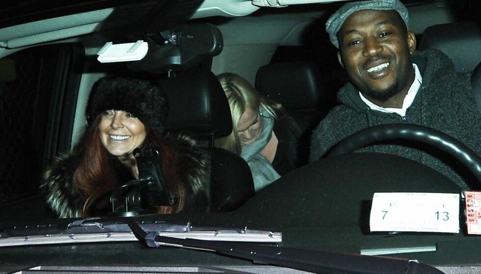 SJÅFØR: Lindsay Lohan på biltur i New York nylig - og overlot kjøringen til en annen. Foto: All Over Press
