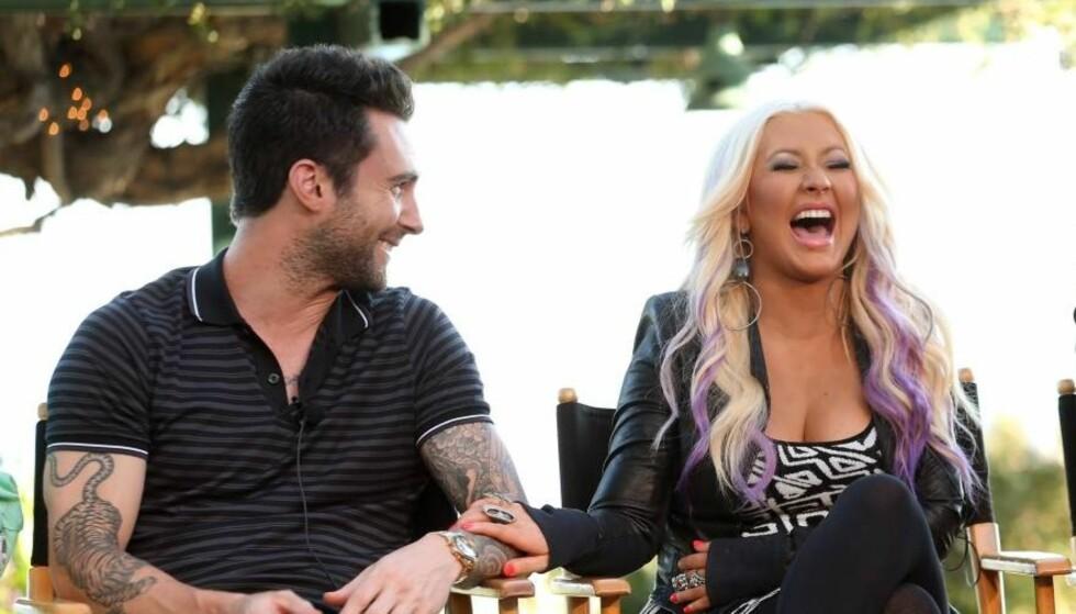 GOD STEMNING: Adam Levine og Christina Aguilera har blitt gode venner etter at de to denne høsten har jobbet side om side på amerikanske The Voice. Foto: All Over Press