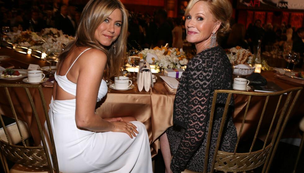 ET GODT SMIL: Aniston mener mye av hemmeligheten bak figuren er å smile mye. Foto: All Over Press
