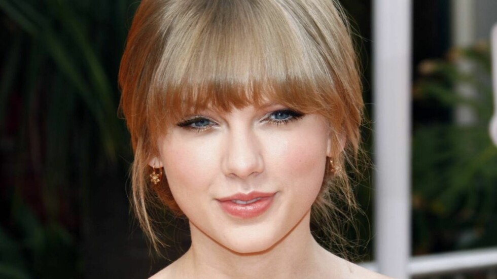 SKUFFET: Taylor Swift ble knust da One-Direction-stjernen Harry Styles kysset en annen kvinne.  Foto: All Over Press