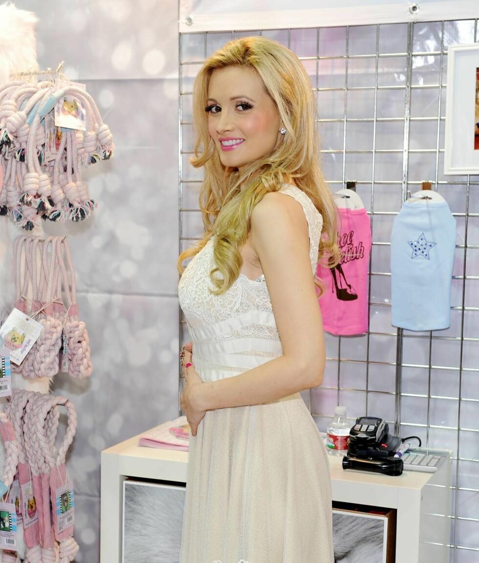 GLAD: I september viste Holly Madison fram sin voksende mage da hun var på et event i Hollywood. Foto: All Over Press