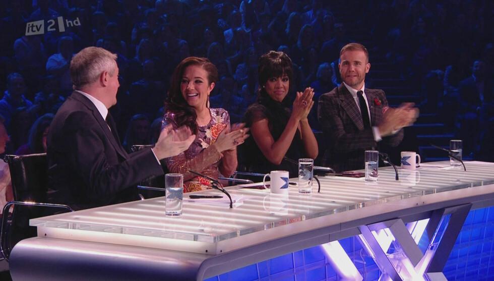TV-DOMMER: Gary Barlow har i flere sesonger vært dommer i den britiske versjonen av TV-programmet «X Factor». Her er han i fjorårets utgave med Louis Walsh, Tulisa Contostavlos og Kelly Rowland. Foto: Stella Pictures