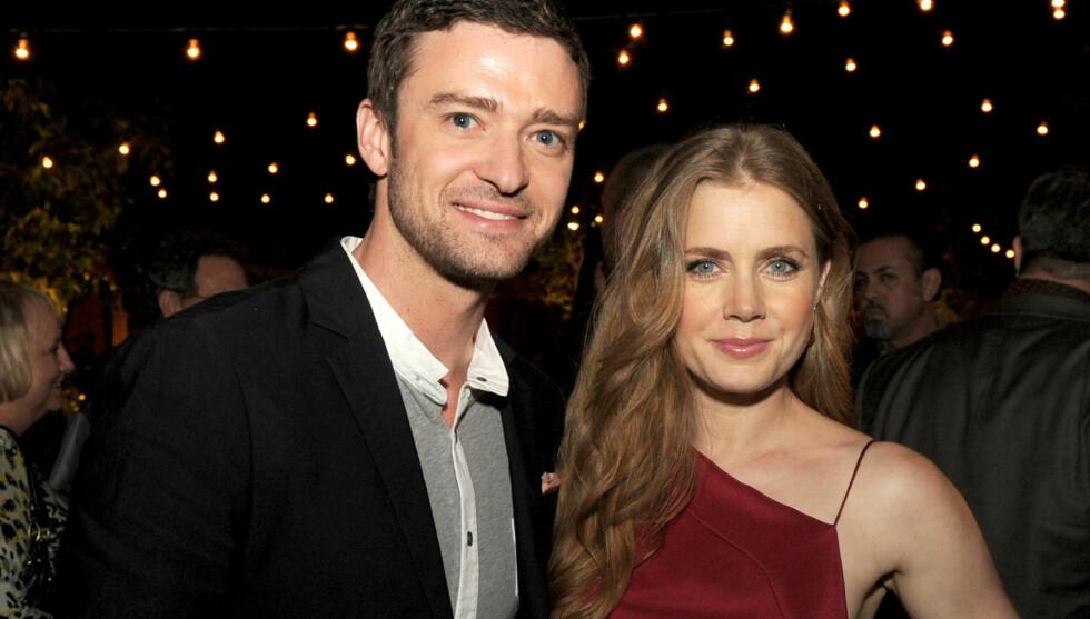 MOTSPILLERE: Justin Timberlake og Amy Adams fikk god kjemi under innspillingen av «Trouble With The Curve». Hun skal blant annet ha reddet livet hans, med leppene, da han holdt på å fryse i hjel under en av scenene. Her er de to avbildet på festen et Foto: All Over Press