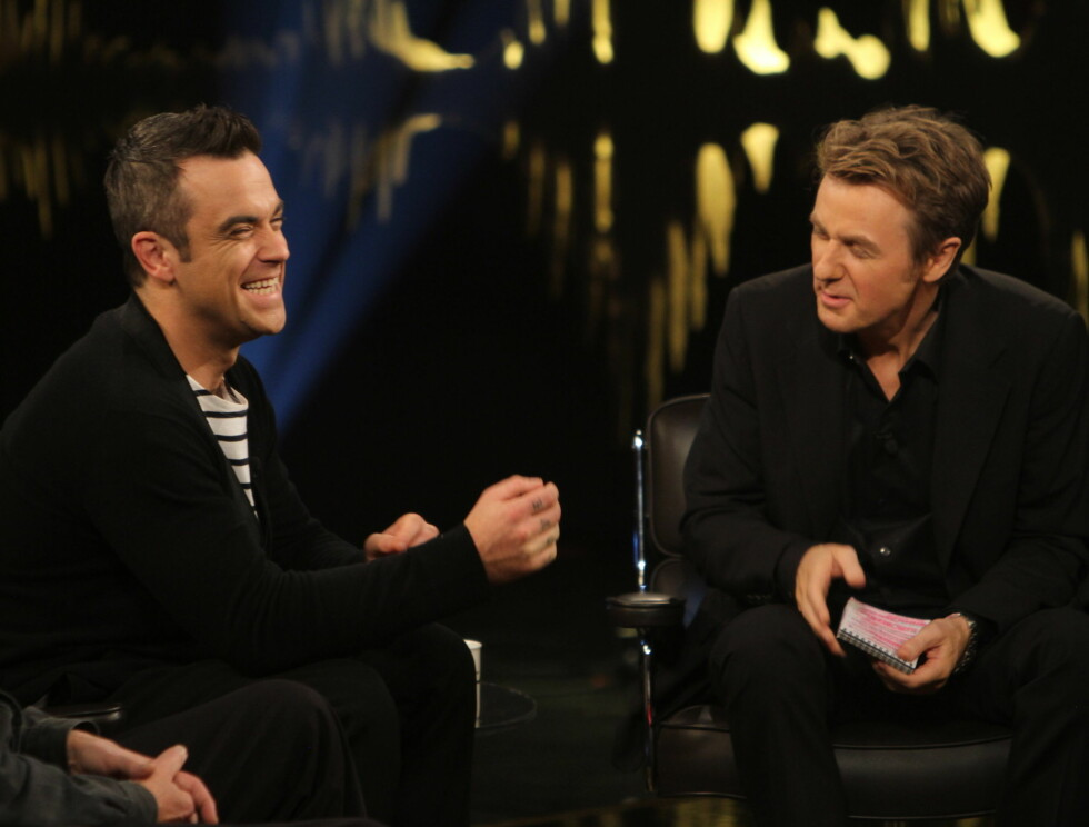 VENNER: Robbie Williams har flere ganger vært gjest hos Fredrik Skavlan Foto: Stella Pictures