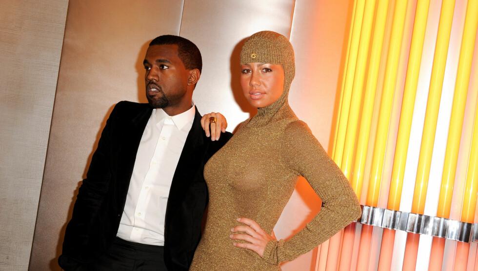 VAR UTRO: Tidligere var Amber sammen med rapperen Kanye West. Men han skal angivelig ha vært utro mot henne med sin nye kjæreste, Kim Kardashian. Foto: Fame Flynet