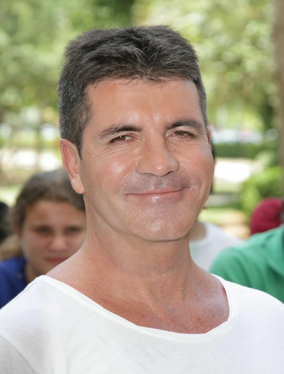 NUMMER #10: Simon Cowell (52) er for tiden dommer i «X Factor» med Britney Spears. Han håvet inn 550 millioner kroner på ett år. Foto: All Over Press