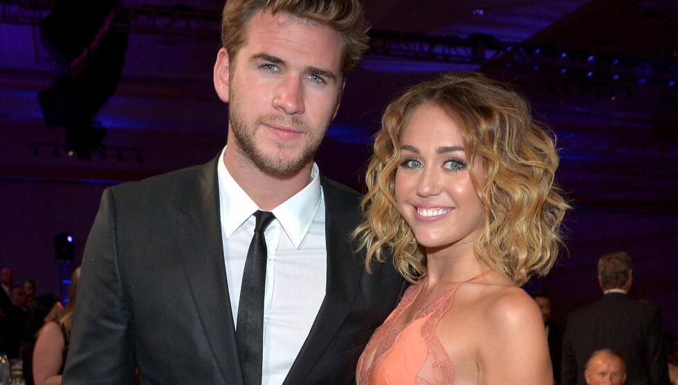FORLOVET: Liam og Miley har datet hverandre i tre år. I juni ble det kjent at de har forlovet seg.  Foto: All Over Press