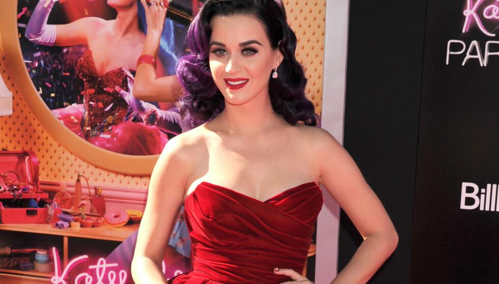NY FLAMME: Katy Perry skal ha falt for John Mayer da de jobbet sammen i studio.  Foto: FameFlynet Norway
