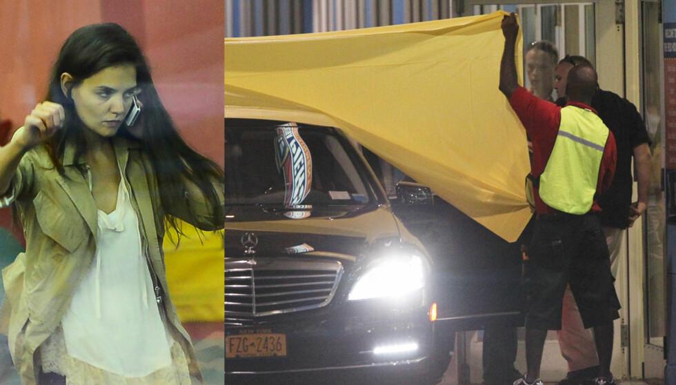 I ULYKKE: Katie Holmes på telefonen etter at bilen hun kjørte i sammen med datteren Suri ble påkjørt av en søppelbil. Foto: All over press