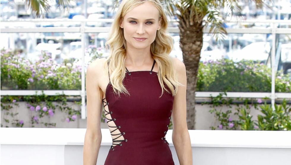 SYLSLANK: Skuespiller og tidligere modell Diane Kruger er en av de slankeste i Hollywood. Ifølge 35-åringen skyldes det ikke bevisst slanking - kun ubevisst ikke-spising. Her er skjønnheten avbildet under filmfestivalen i Cannes i mai.  Foto: Stella Pictures
