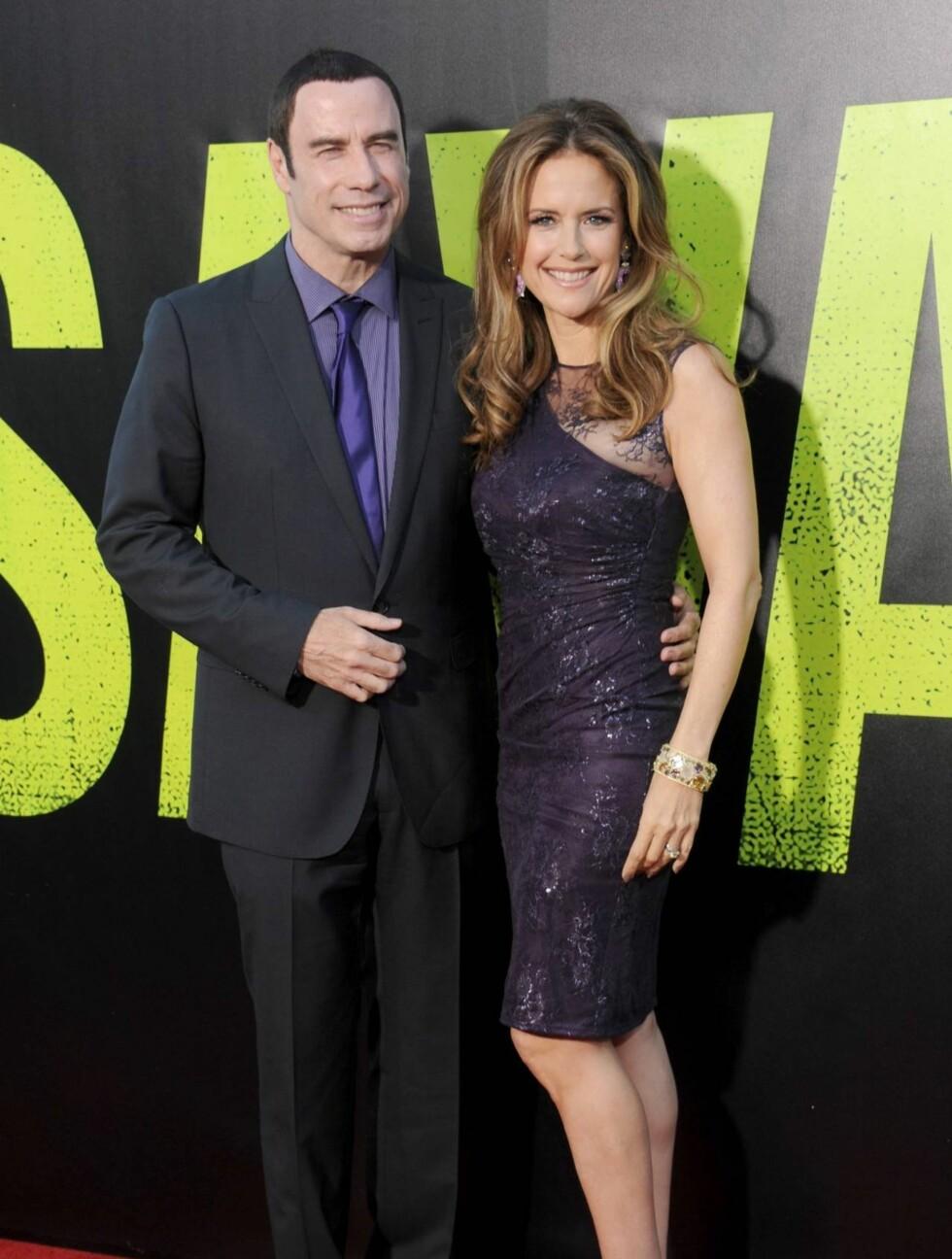<strong>TILBAKE ETTER SKANDALEN:</strong> John Travolta har blitt anklaget for å ha seksuelt trakassert flere mannlige massører. På premieren la han problemene bak seg og koste seg med konen Kelly Preston.  Foto: All Over Press