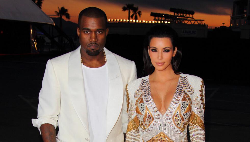 NYTT PAR: Nyiig viste Kanye West og Kim Kardashian sin kjærlighet for verden, men paret skal ha blitt sammen da Kim var gift med Kris.  Foto: All Over Press