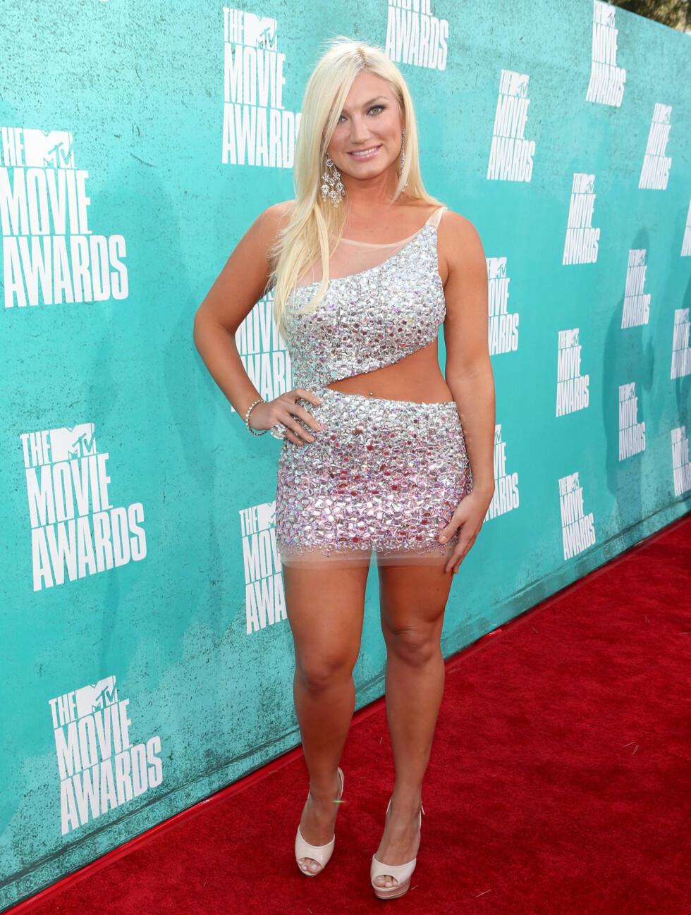 VÅGALT: TV-personlighet Brooke Hogan i en kjole av det mer vågale slaget på nattens MTV Movie Awards. Foto: All Over Press