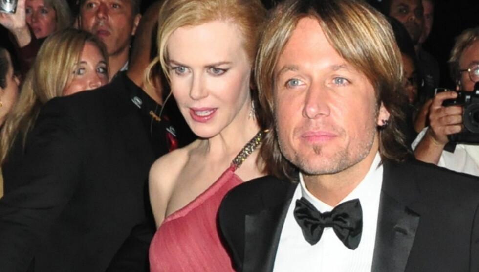 EKTEPAR PÅ LØPEREN: Nicole Kidman og Keith Urban på premieren av hennes nye film, Paperboy, i Cannes. Foto: All Over Press