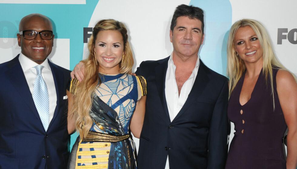 HER ER DOMMERNE: Dommerne i andre sesong av amerikanske X Factor, fra venstre. Atonio Reid, Demi Lovato, Simon Cowell og Britney Spears. Foto: All Over Press