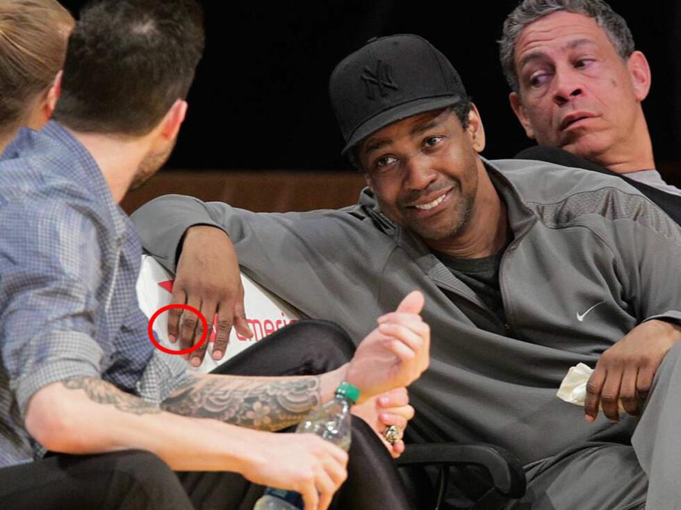 <strong>MISDANNETE FINGRE:</strong> Denzel Washington har en varig misdannelse i sin ene hånd, etter at han ifølge Radaronline.com brakk lillefingeren som liten, og aldri fikk operert den. Foto: All Over Press