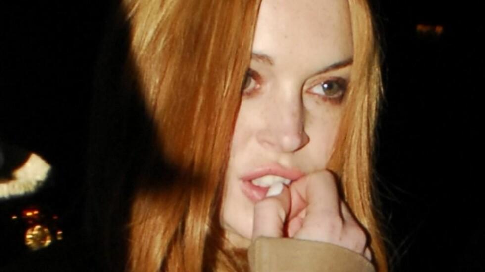 <strong>GJEMMER SEG:</strong> Om to uker møter Lindsay Lohan i retten igjen og nekter nå å forlate huset sitt for å unngå skandaler før rettsmøtet.  Foto: All Over Press
