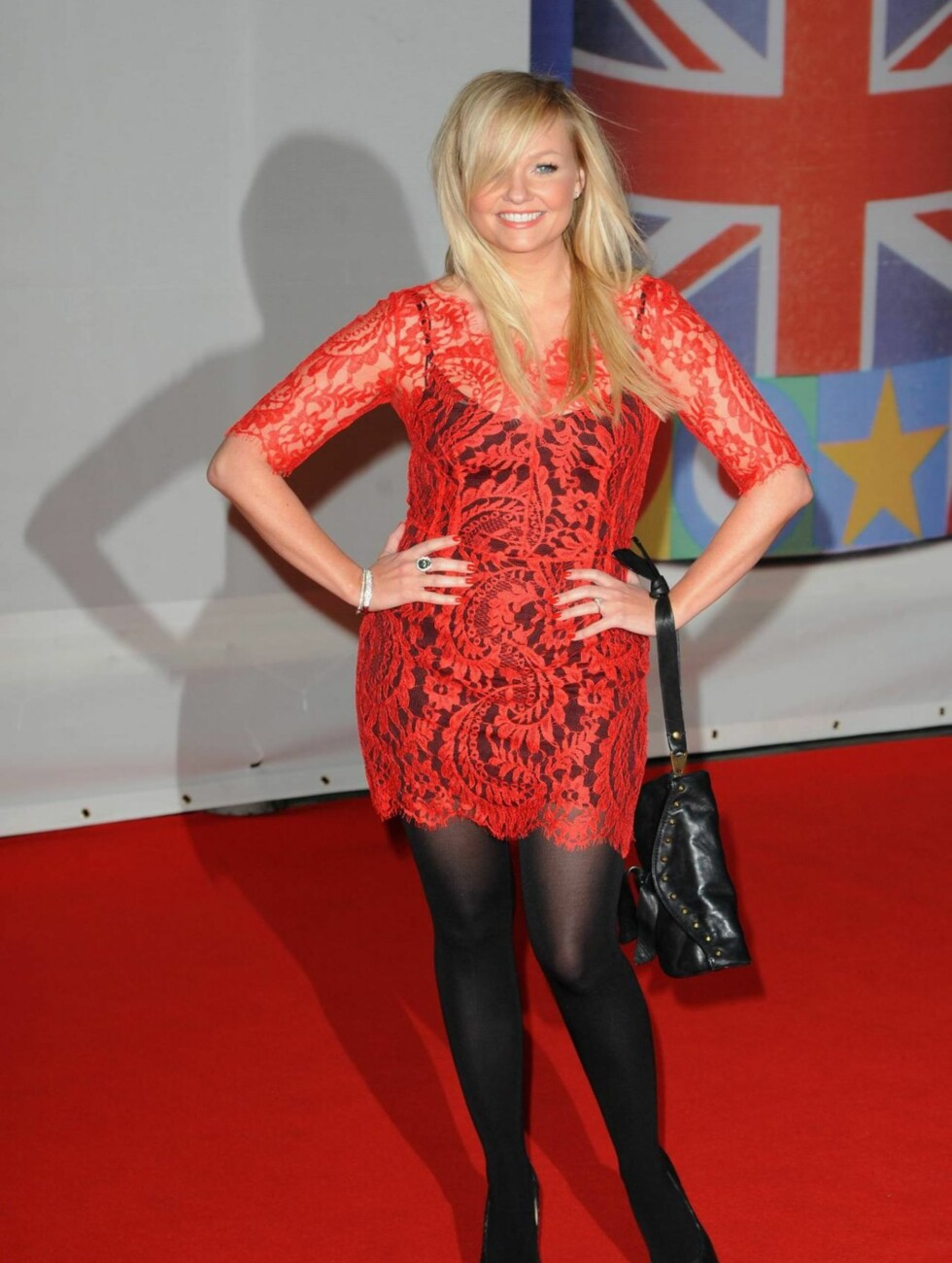 <strong>KORT:</strong> Tidligere Spice Girls-stjerne Emma Bunton kom i en kort, rød blondekjole.  Foto: All Over Press