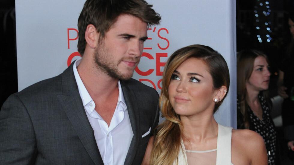 <strong>TRUER MED BRUDD:</strong> Liam Hemsworth ønsker at kjæresten Miley Cyrus skal fjerne alle tatoveringene sine, ellers truer han med brudd.  Foto: UPI