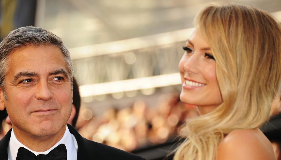 STORKOSTE SEG: George Clooney og Stacy Kiebler storkoste seg på den røde løperen.  Foto: All Over Press