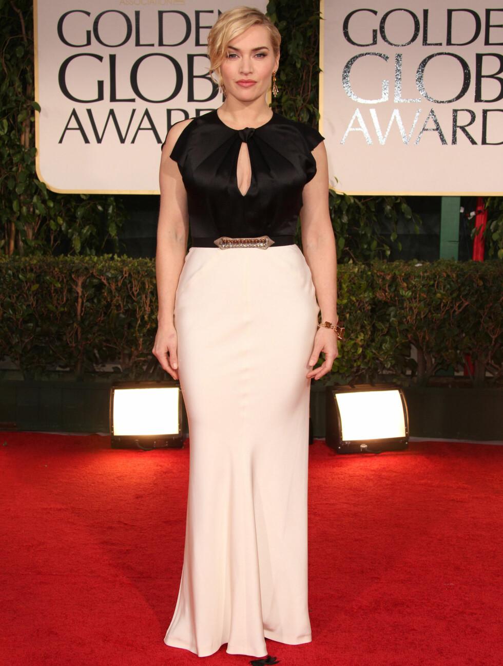 SORT OG HVIT: Kate Winslets kjole viste frem hennes flotte former. Den elegante to-fargede kjolen er signert Jenny Packham.  Foto: Stella Pictures