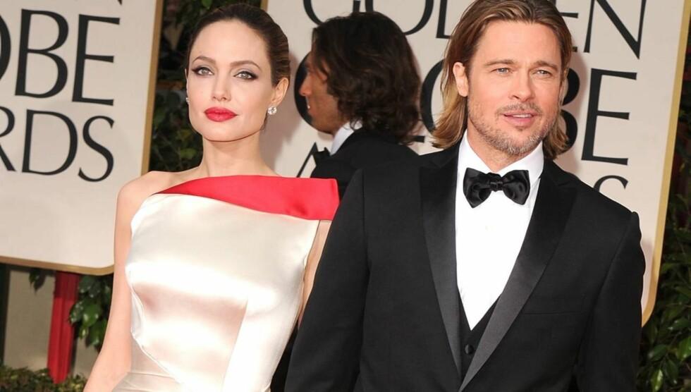 IKKE SYNLIG: Ingen kan se at Angelina Jolie mangler en del av albuen. Her er hun sammen med Brad Pitt på utdelingen av Golden Globe.  Foto: All Over Press