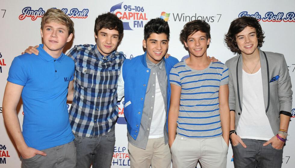 BOYBAND: Harry Styles (t.h.) er sanger i den britiske boybandgruppen One Direction. Foto: Stella Pictures