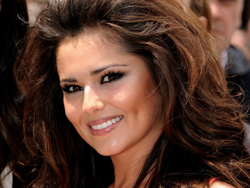 INGEN MOTELØVE: Den britiske popsangeren Cheryl Cole blåser i at hun får kritikk for stilen. - Jeg velger å ikke følge trender, sier hun. Foto: All Over Press
