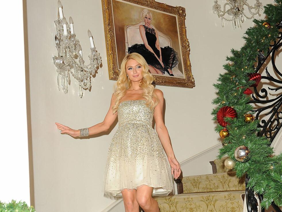 OVERDÅDIG: Festen var i Paris' eget hus i Beverly Hills. Alle veggene er pyntet med bilder av arvingen selv.  Foto: All Over Press