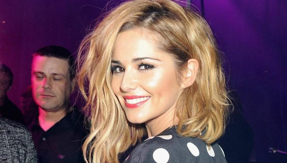 SMILER: Cheryl Cole skal endelig ha funnet lykken igjen. Foto: All Over Press