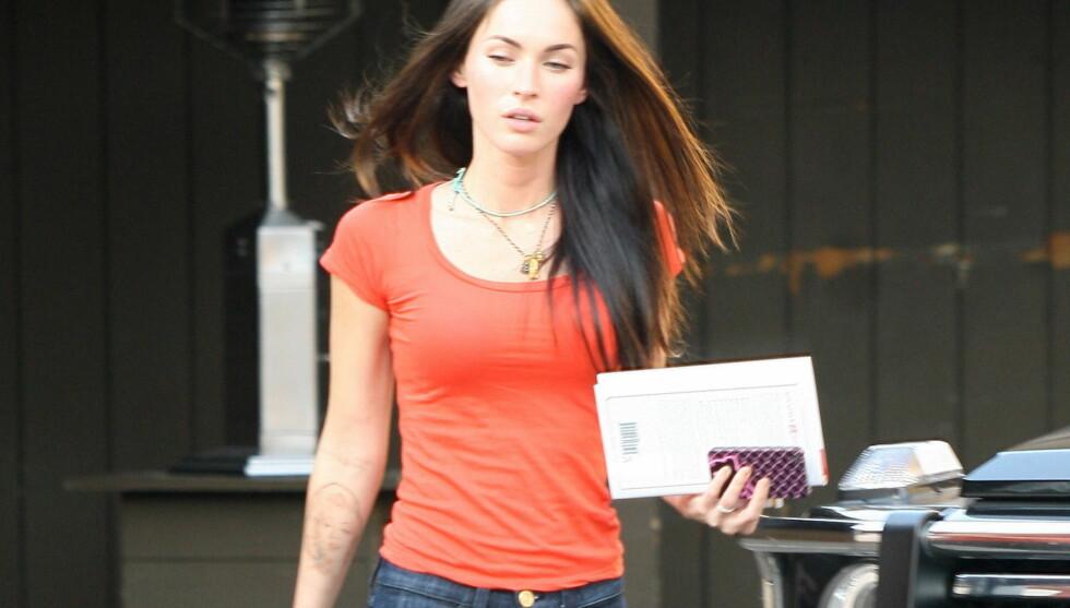 <strong>FØR:</strong> Vakre Megan Fox har rundt ni tatoveringer på kroppen sin, men hun er ikke like fornøyd med alle. Foto: All Over Press