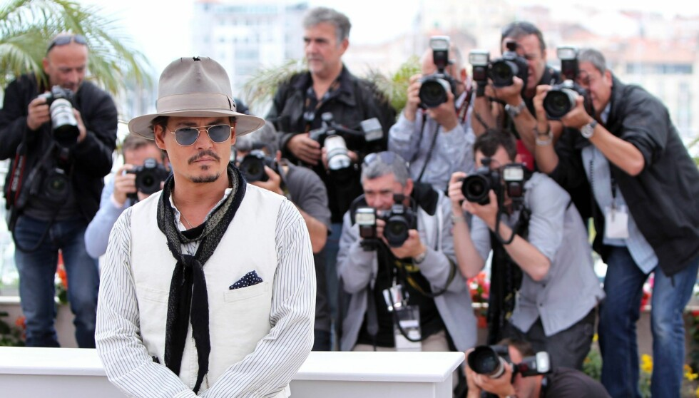 <strong>SJOKKERER:</strong> Skuespilleren Johnny Depp synes det er så ille å få medieoppmerksomhet at han sammenligner det med å bli voldtatt. Likevel stiller han på Cannes Festivalen, som her. Foto: All Over Press