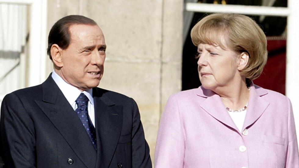 TELEFONTABBE: Italias stasminister Silvio Berlusconi kom med en temmelig grov uttalelse om sex-appealen til Tysklands forbundskansler Angela Merkel (t.h) i en avlyttet telefonsamtale. Her er de to statslederne avbildet i Frankrike i 2008.  Foto: Stella Pictures