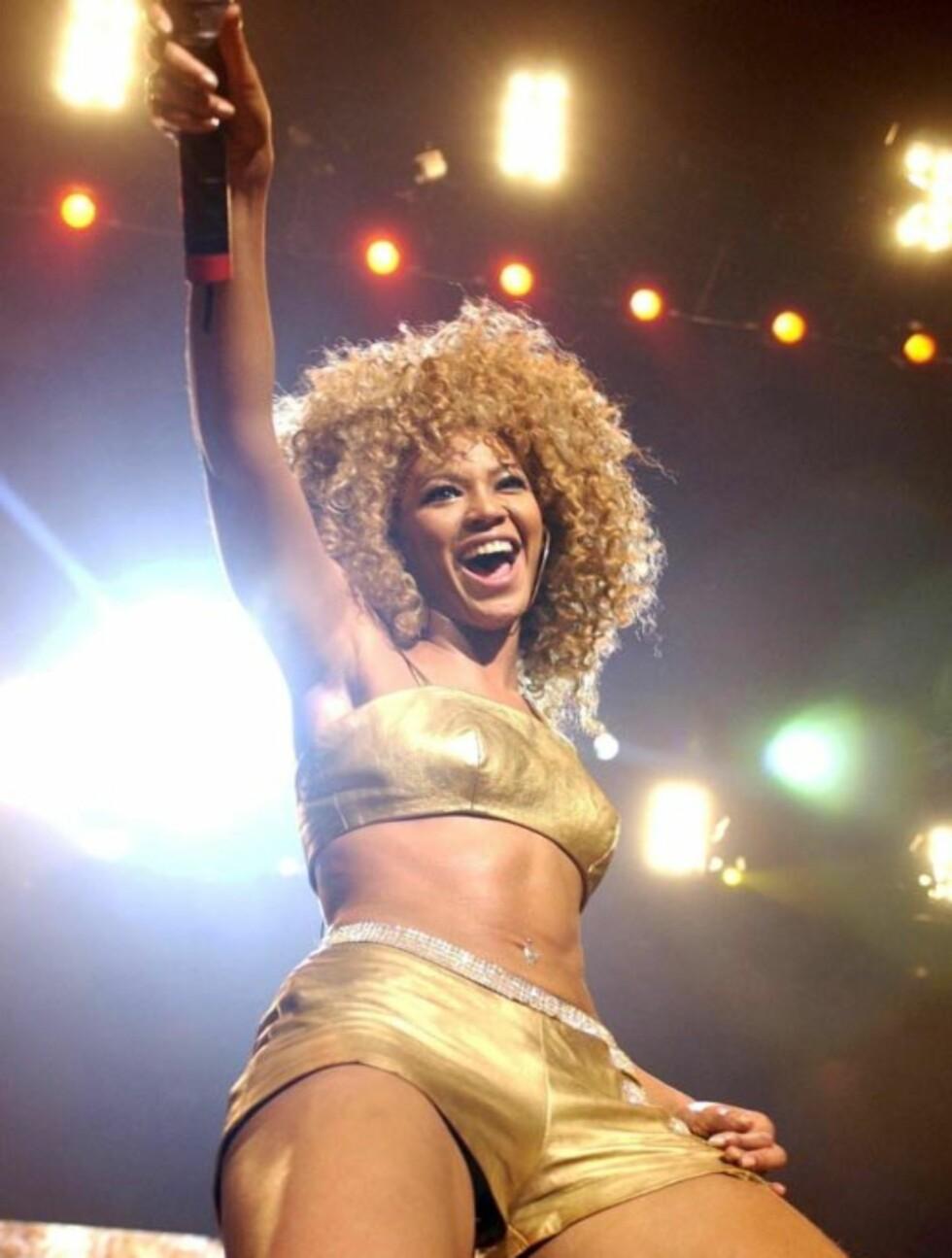 <strong>2002:</strong> Her er Beyoncé under en opptreden med Destiny's Child på London Arena.  Foto: All Over Press