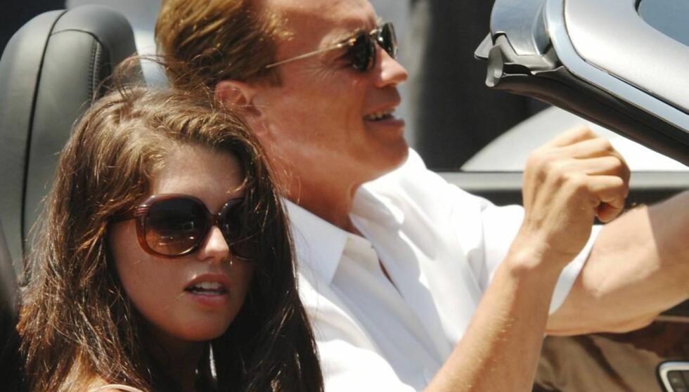 TØFF TID: Katherine Schwarzenegger hevder hun og søsknene har hatt det tøft etter at faren Arnolds utroskap-skandale ble kjent tidligere i år. Her er de to sammen i 2007. Foto: All Over Press