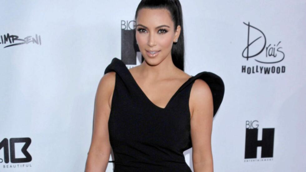 LEKKER: Reality-stjernen Kim Kardashian gifter seg til helgen, og skjønnheten skal ha trent hardt og spist sunt for å se best mulig ut i sin Vera Wang-kjole. På lanseringen av Worlds Most Beautiful Magazine, der hun selv er på coveret, i forrige uke s Foto: Stella  Pictures