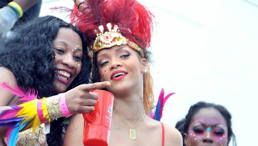 AMBASSADØR: Den sexy popstjernen har blitt utnevnt som ambassadør i hjemlandet Barbados - og ser ut til å ta oppgaven med stor glede. Foto: All Over Press