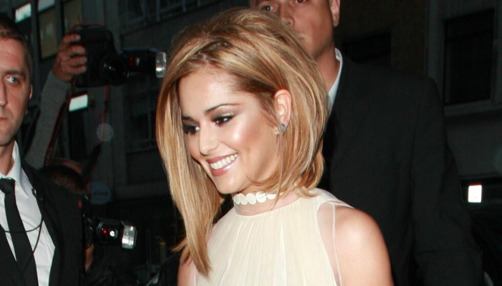 <strong>YDMYKET:</strong> Cheryl Cole smilte fra øre til øre på da hun feiret 28 årsdagen med å offentliggjøre forholdet til Ashley igjen. Men nå er forholdet på nytt i grus.  Foto: All Over Press