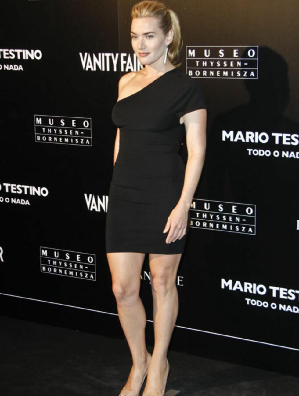 FLOTT: Med sine sterke, klassiske trekk trenger ikke Kate Winslet mye ekstra staffasje for å stråle på den - sorte -løperen. Her avbildet på åpningen av en ny Mario Testino-utstilling i Madrid. Foto: All Over Press