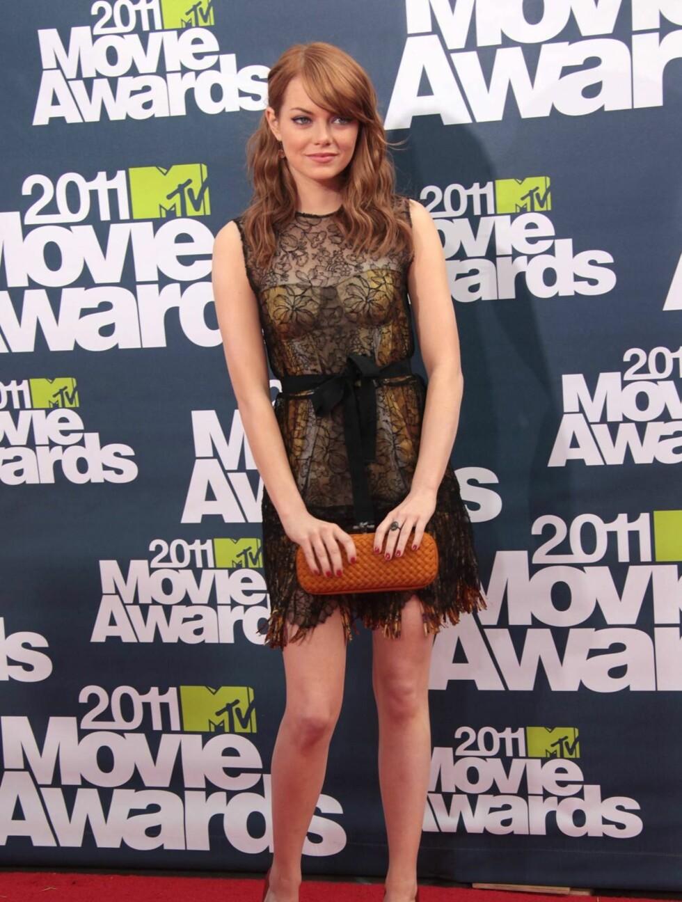 <strong>NY STJERNE:</strong> Skuespilleren Emma Stone kom i kjole fra Bottega Veneta , sko fra Casadei og hadde også med en veske fra Bottega Veneta. Foto: All Over Press
