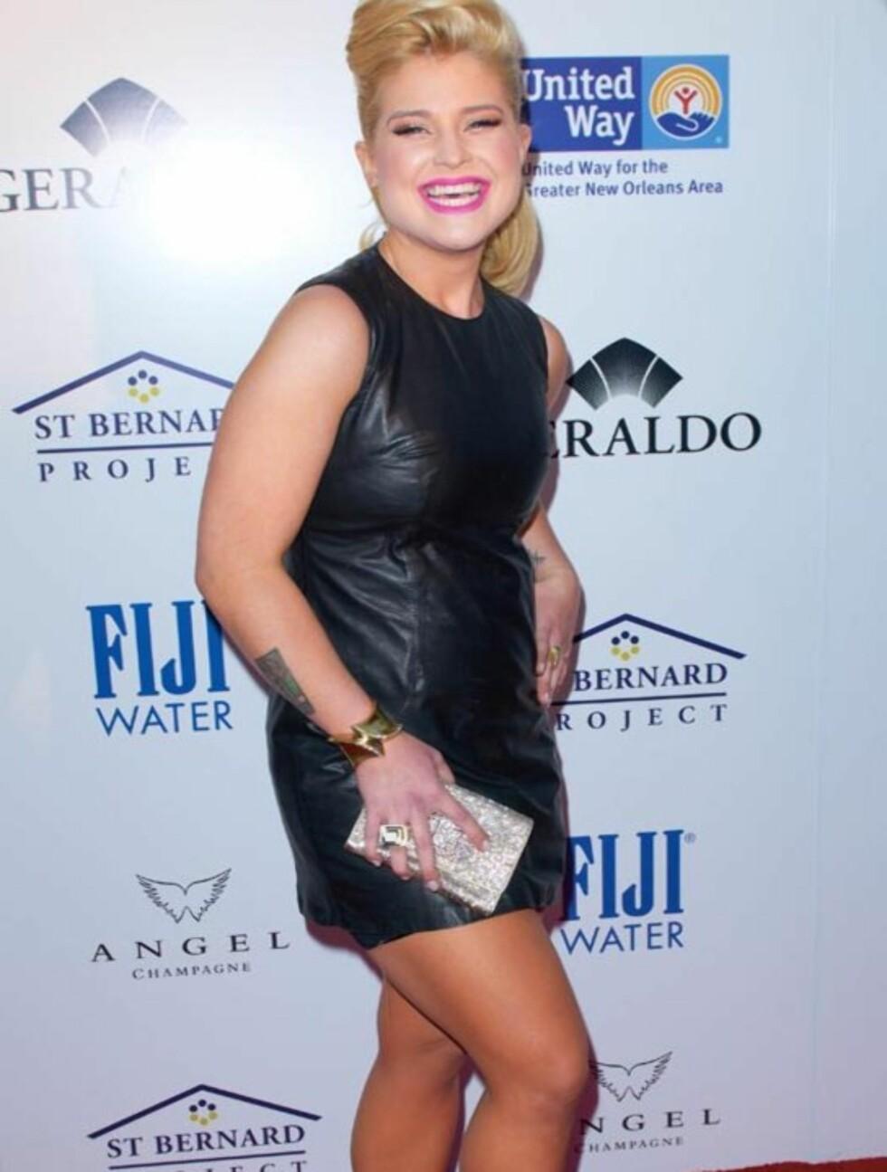 <strong>FORNØYD:</strong> Kelly Osbourne koste seg på den røde løperen.  Foto: All Over Press