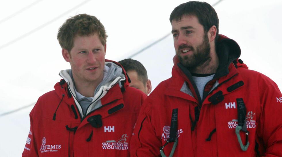 <strong>PÅ SVALBARD:</strong> Storbritannias prins Harry (t.v) befinner seg om dagen på norsk jord - prinsen er nemlig på Svalbard for å forberede seg til en ekspesisjon til Nordpolen. Om turen lykkes vil den få en plass i rekordbøkene, som den første ekspedisjonen Foto: Reuters/Scanpix