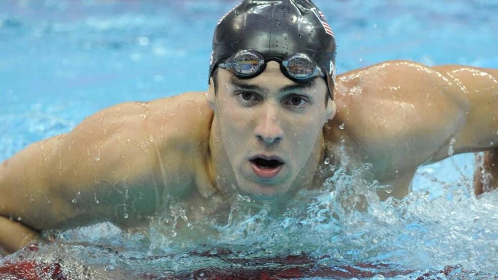 FOLKEHELT: Michael Phelps har fått en varm velkomst i hjemlandet USA etter imponerende prestasjoner under OL i Beijing. Nå vil også Hollywood ha en bit av ham. Foto: SCANPIX