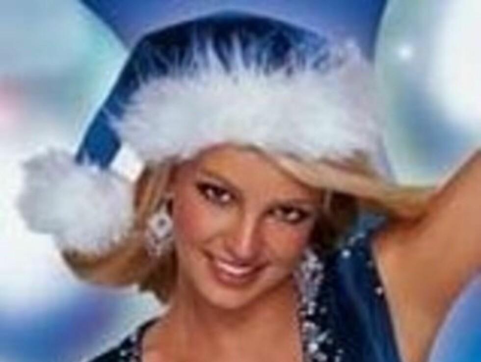 TIL SALGS: Britneys blå nissedrakt fra en Pepsi-reklame blir lagt ut på auksjon, sammen med flere plagg. Foto: Pepsi